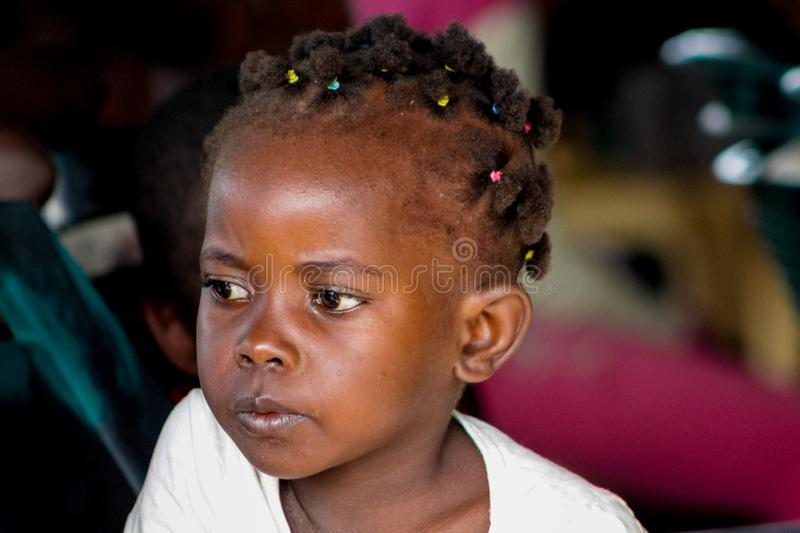 African little child girl portrait big eyes looking. African little child portrait big eyes looking on camera, small kid play in Africa. Children portraits on stock photos