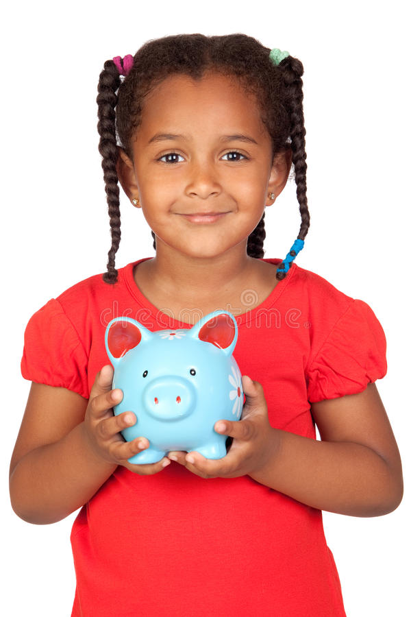 African little girl with a blue piggy-bank. Isolated on a over white stock images