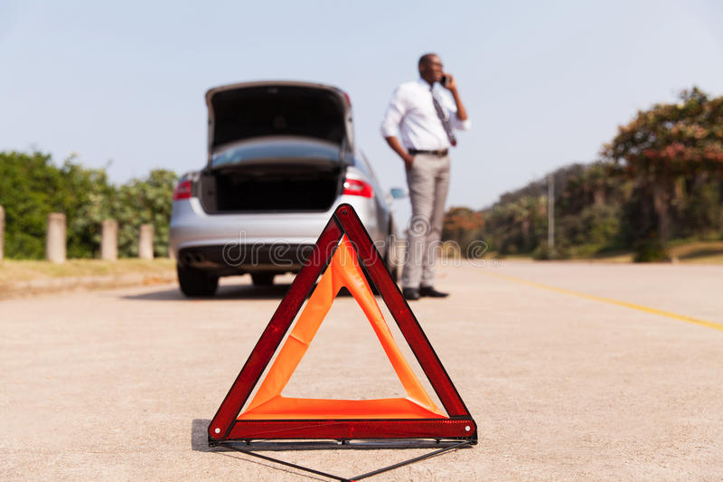 African male driver calling. For help after car broke-down by the side of the road stock photos