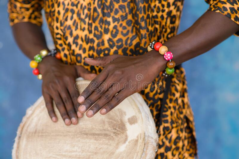 African male hands playing on jembe drum, closeup stock images