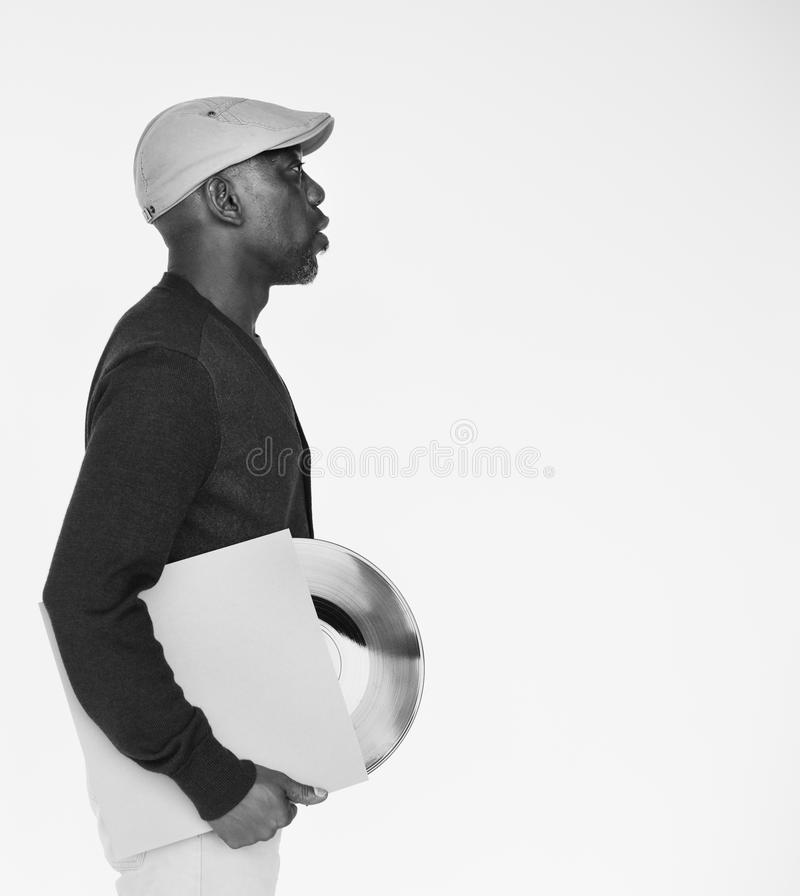 African Male Holding Vinyl Record Concept stock photos