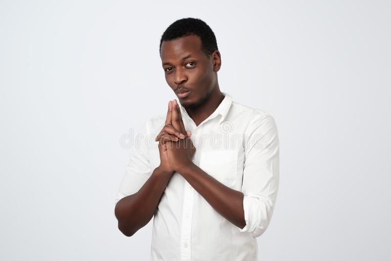 african male student in white shirt makes shooting gesture, ready to reach success. Self assurance concept royalty free stock images