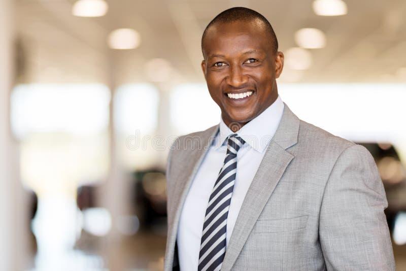 African man car dealership. Handsome african man working at car dealership royalty free stock images