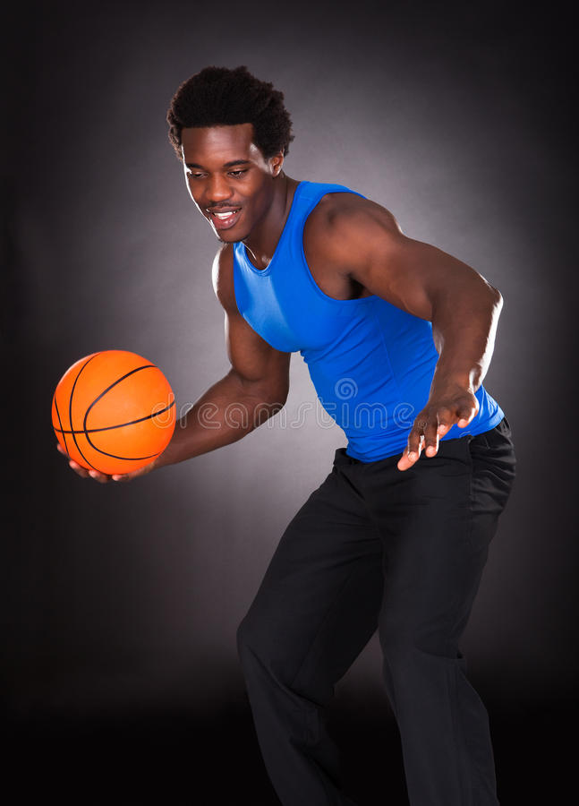 African Man Carrying Basketball royalty free stock photography