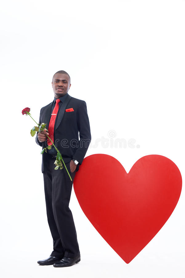 African man holding rose, present for Valentine Day royalty free stock photography