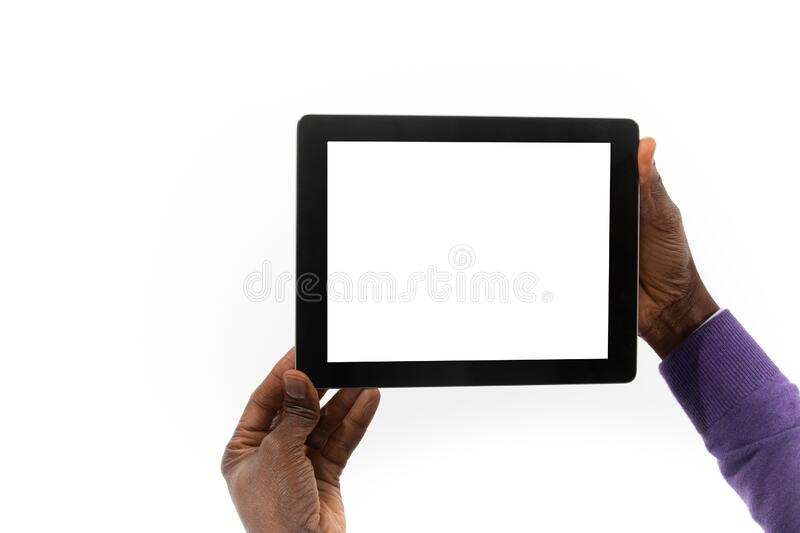 African man holding a tablet computer in his hand royalty free stock images