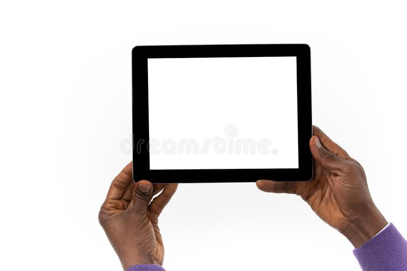 African man holding a tablet computer in his hand stock photos