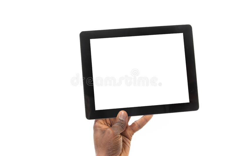 African man holding a tablet computer in one hand royalty free stock photos