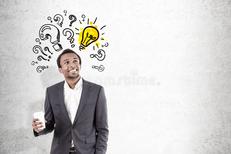 African man, light bulb and questions, concrete royalty free stock photography