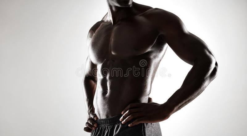African man with muscular body on grey background royalty free stock photos