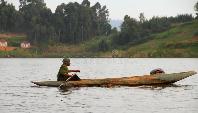 Download African Man Paddles Dugout Canoe Editorial Image - Image: 31369790