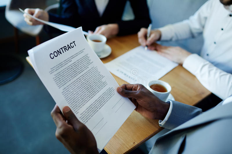 African Man Reading Contract royalty free stock photography
