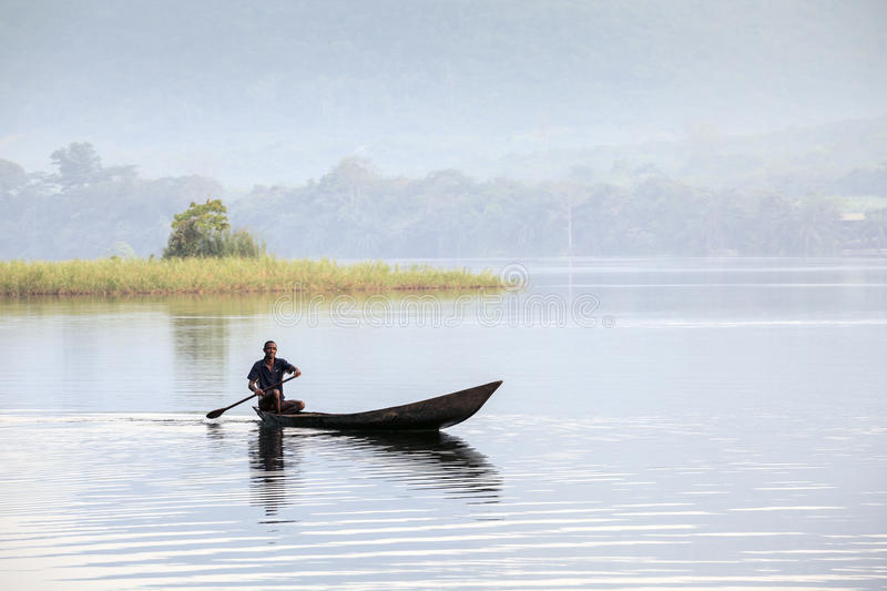 African man riding a canoe stock image