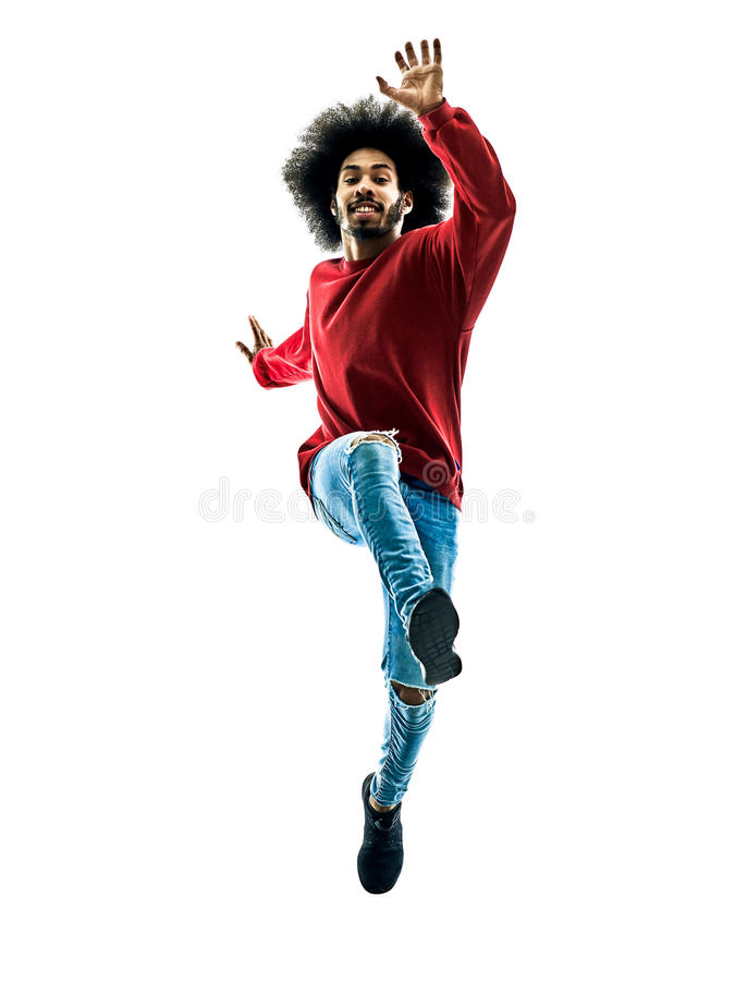 African man running jumping saluting isolated. One african man running jumping saluting in silhouette isolated on white background royalty free stock photography