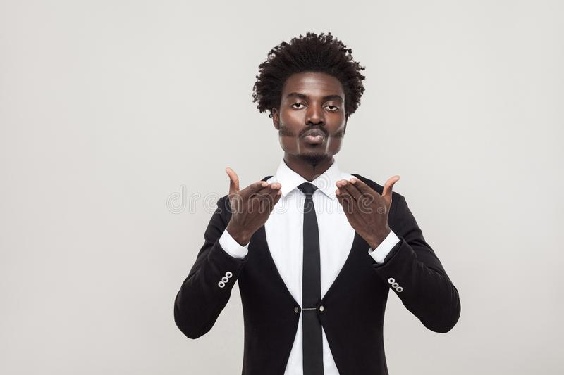 African man send air kissing at camera with love. African man send air kissing at camera with love . Studio shot, gray background royalty free stock photo