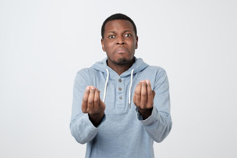 African man showing italian gesture that means what do you want over white background. Handsome african man showing italian gesture that means what do you want stock image