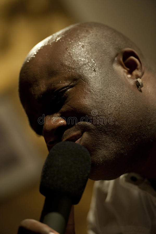 Download African man singing live stock image. Image of detail - 23571579