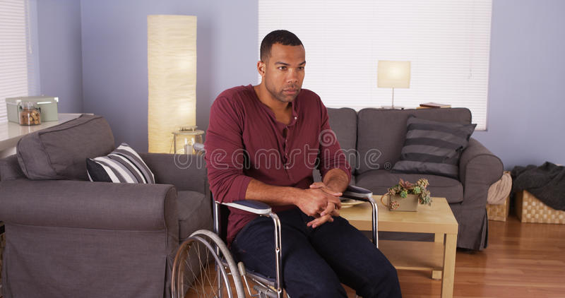 African man sitting in wheelchair royalty free stock images
