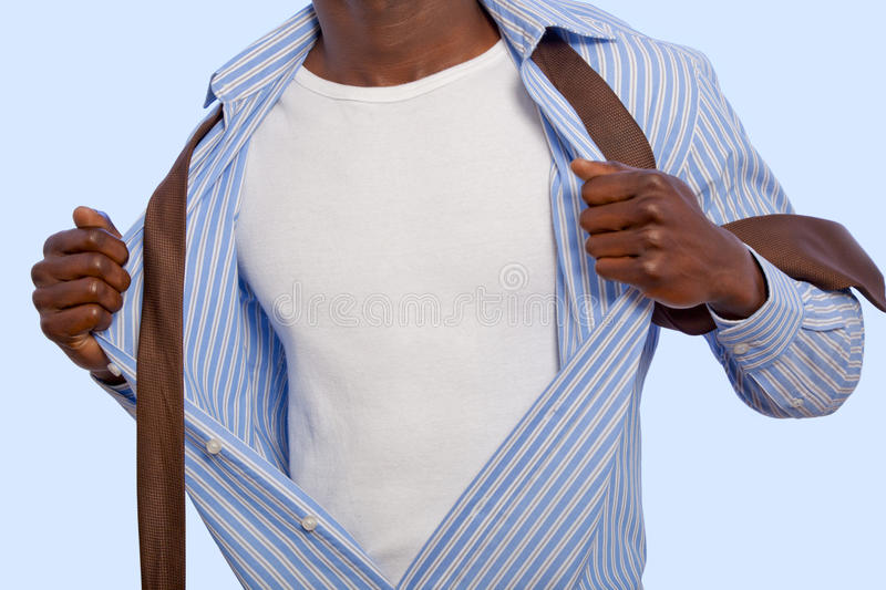 African man taking off his suit royalty free stock photography