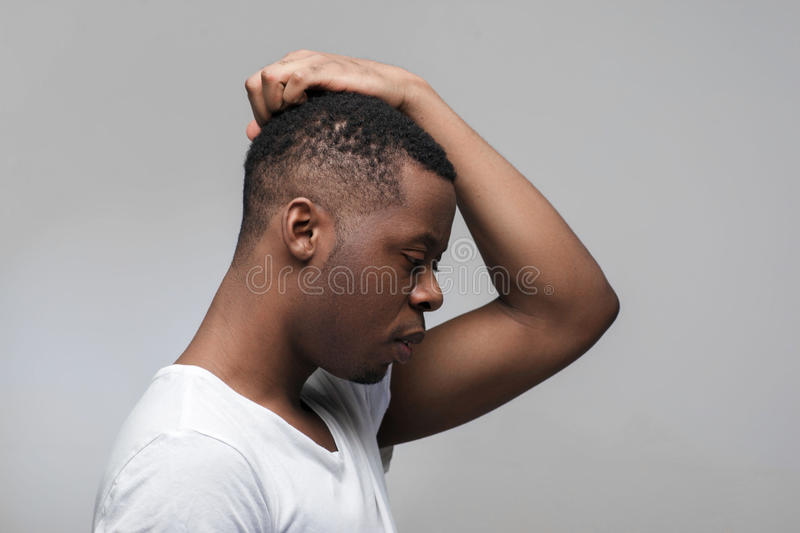 African man thinking. Concentrated on thoughts. stock images