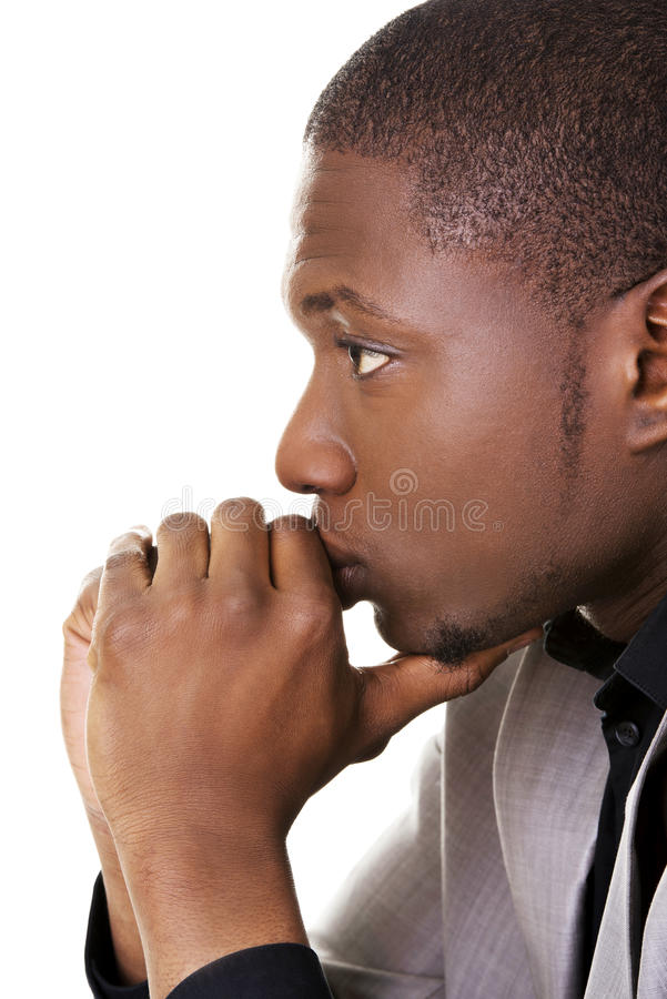 African man thinking about an idea. Attractive african man thinking about an idea stock photos