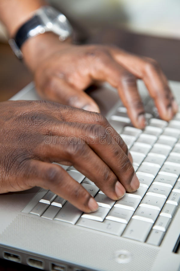 African man working on a computer stock photos