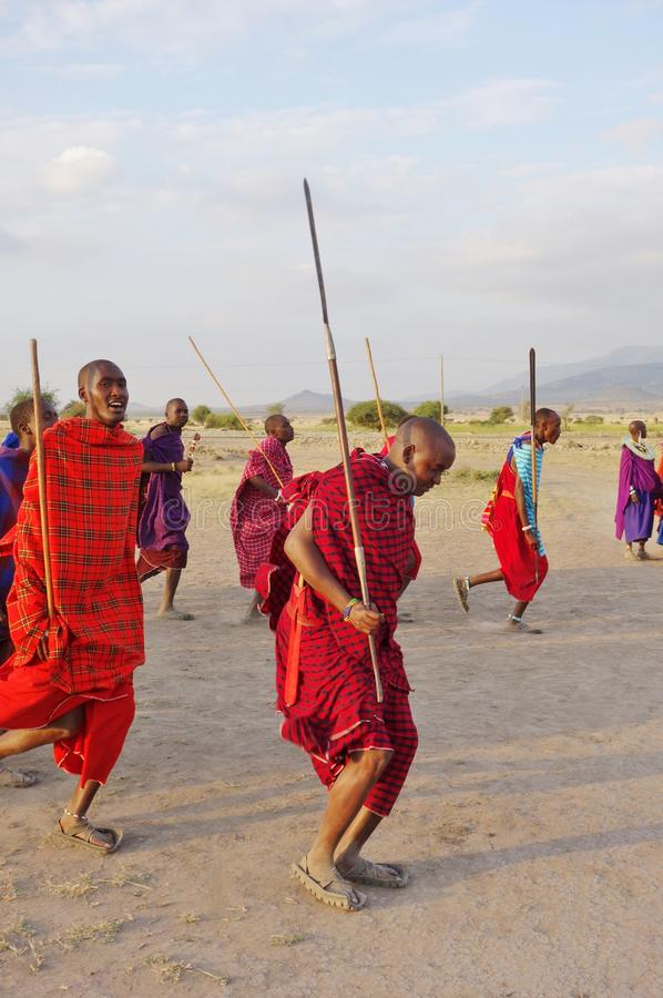 African Masai people dressed in traditional clothing around Arusha, Tanzania royalty free stock photo