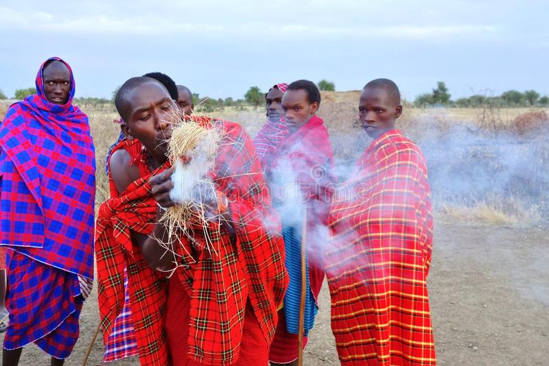 African Masai people dressed in traditional clothing around Arusha, Tanzania stock photos