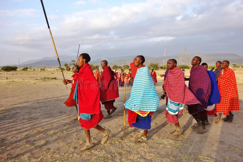 African Masai people dressed in traditional clothing around Arusha, Tanzania royalty free stock image