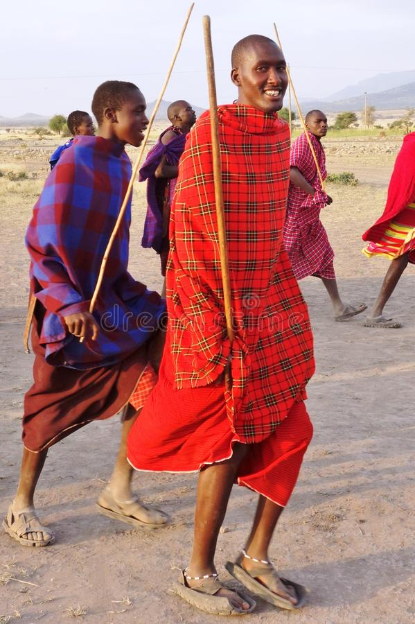 African Masai people dressed in traditional clothing around Arusha, Tanzania royalty free stock images