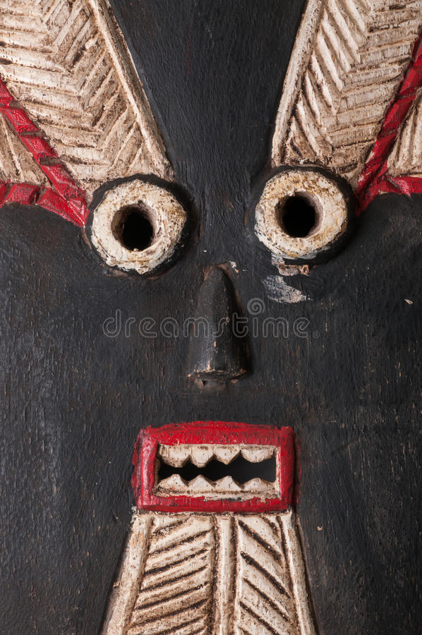 Goli African Carved Mask. Close up detail of a Baule Goli female mask from Ivory Coast/Africa, carved in wood with pigment patina stock photography
