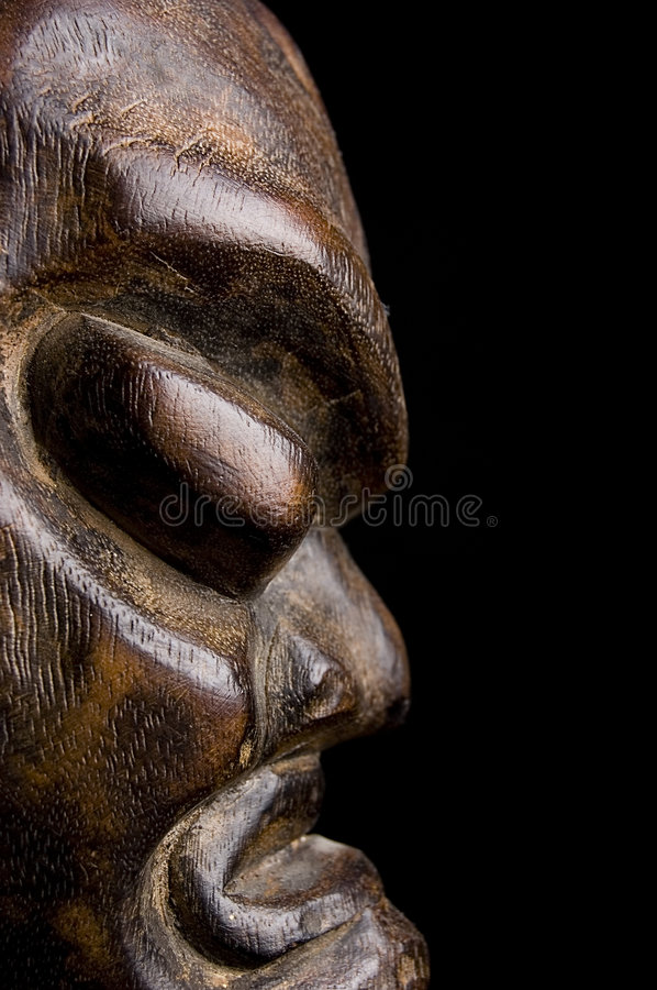 African mask over black background royalty free stock image