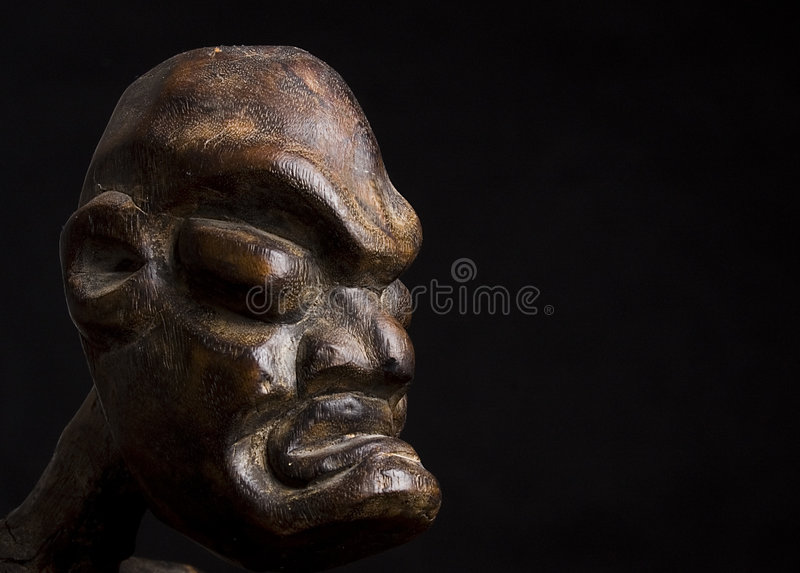 African mask over black background royalty free stock photography