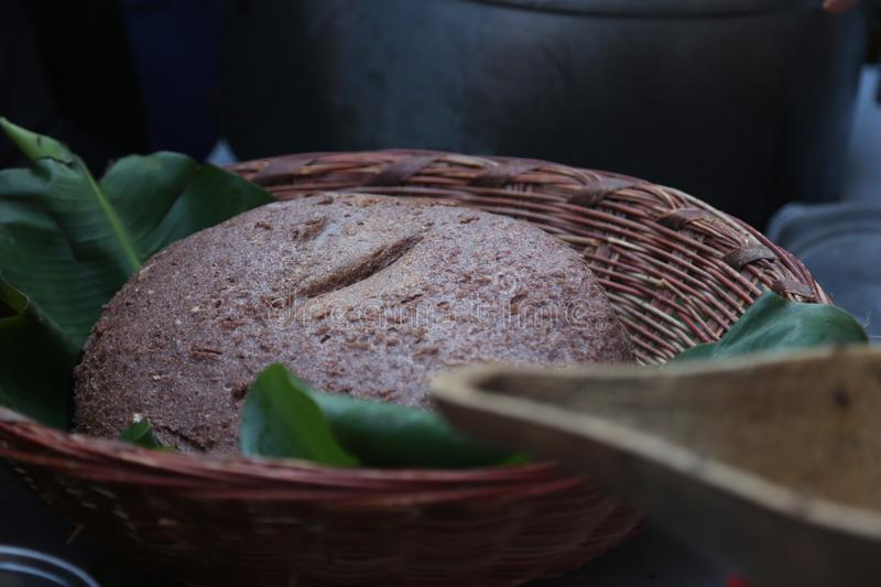 An African meal of sorghum and maize meal bread `ugali` stock photography