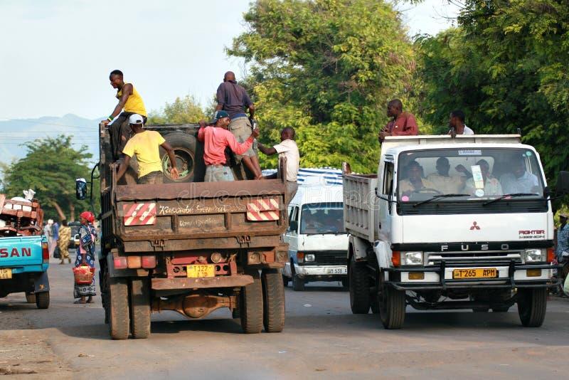 African men make trip back of a truck. Makuyuni, Arusha, Tanzania - February 13, 2008: Transportation of passengers, African men make the trip back of a truck royalty free stock photos