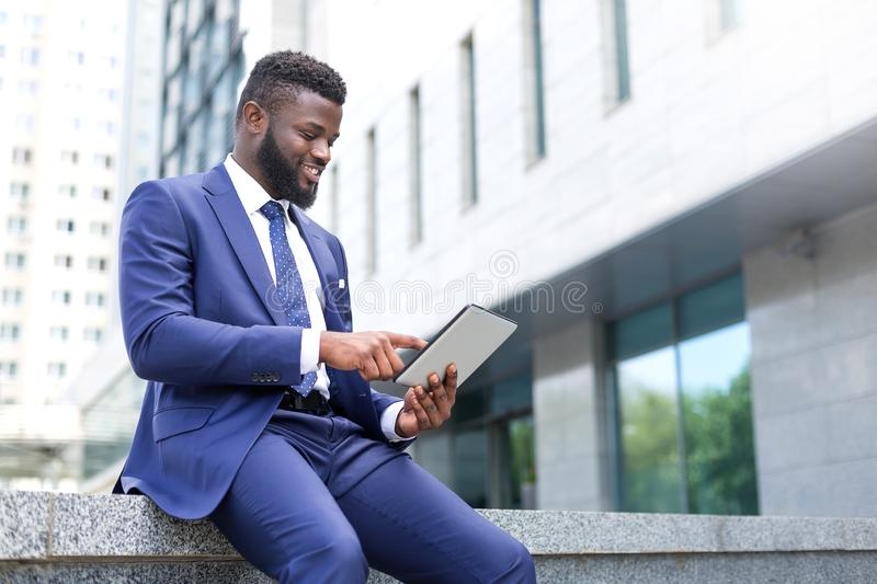 African millennial using technology as a proficient way to work stock photo