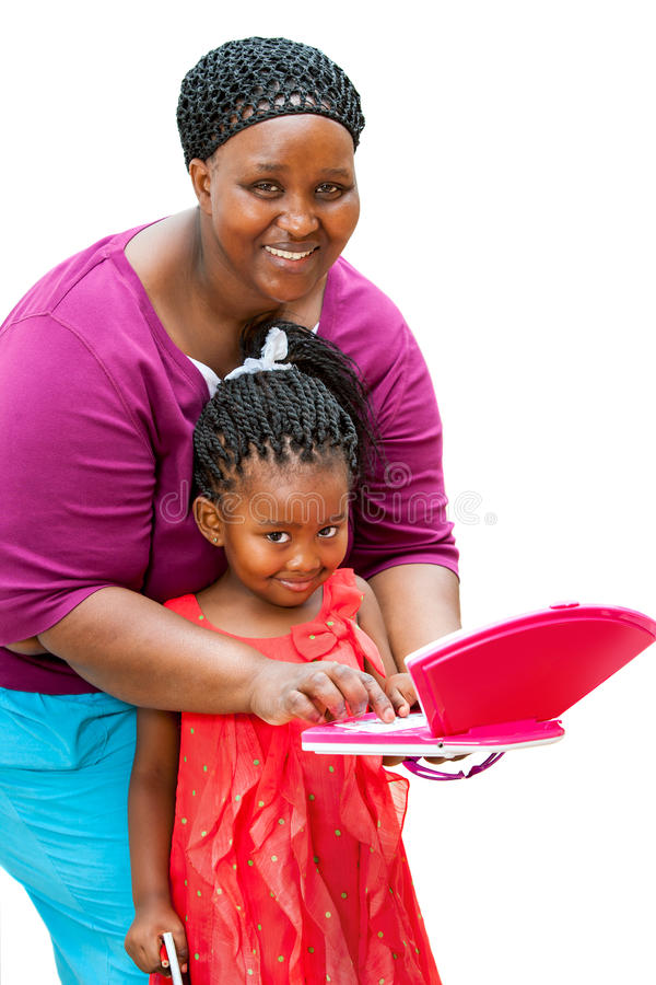 African mother helping child on laptop. stock photos