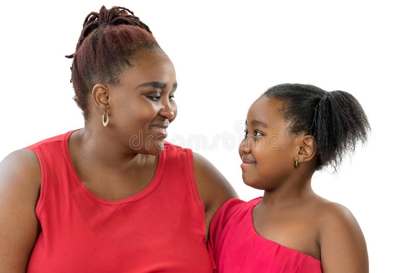 African mother with little daughter looking at each other isolated. stock photography