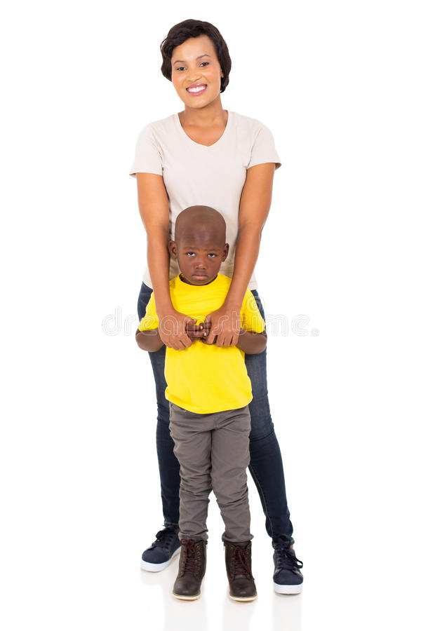 African mother son. Attractive african mother and son standing together on white background royalty free stock photos