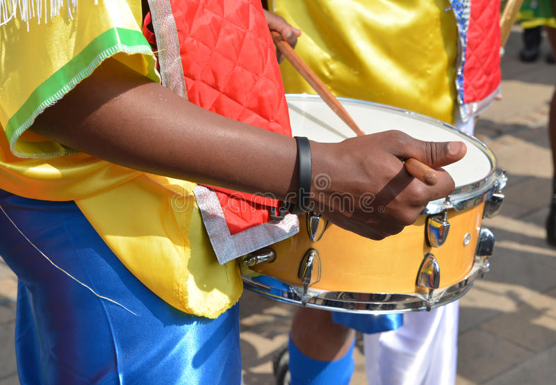 African musician playing drum in festival stock image