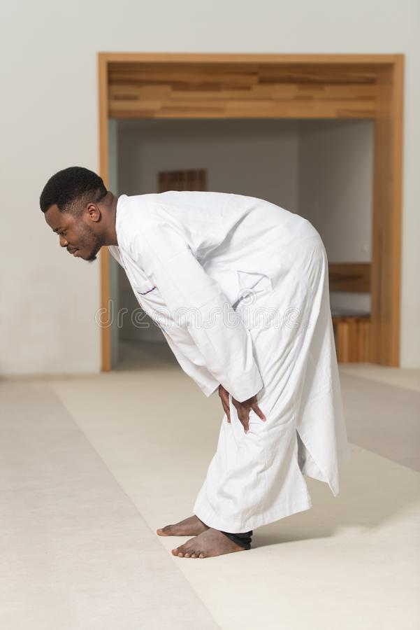 African Muslim Praying In Mosque stock photo