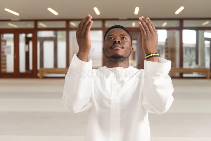 Young Muslim Guy Praying royalty free stock photo