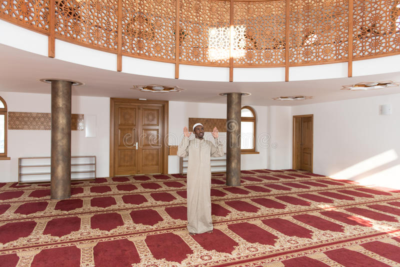 African Muslim Man Is Praying In The Mosque royalty free stock images