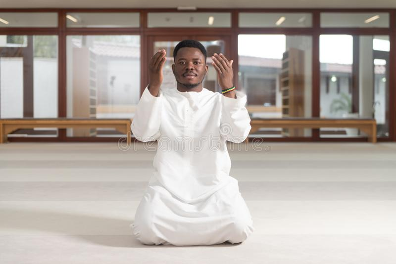 African Muslim Praying In Mosque royalty free stock photo