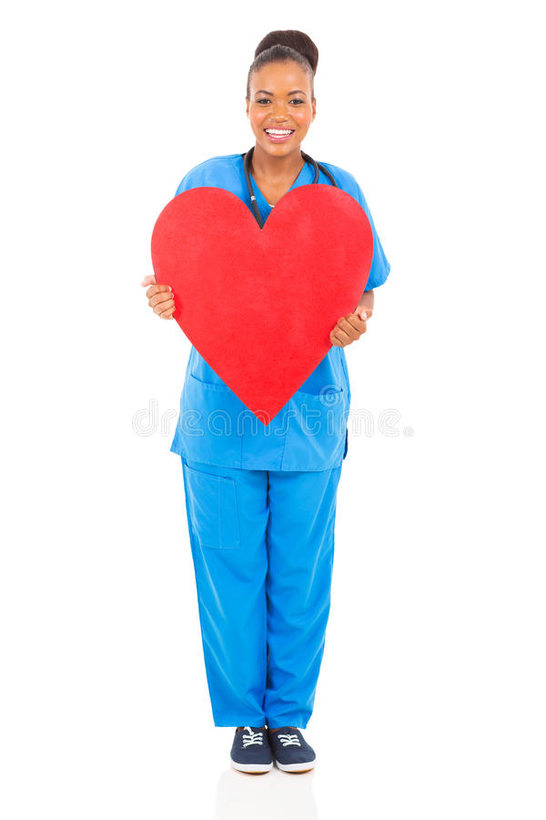African nurse heart. Happy african nurse holding heart shape stock photography