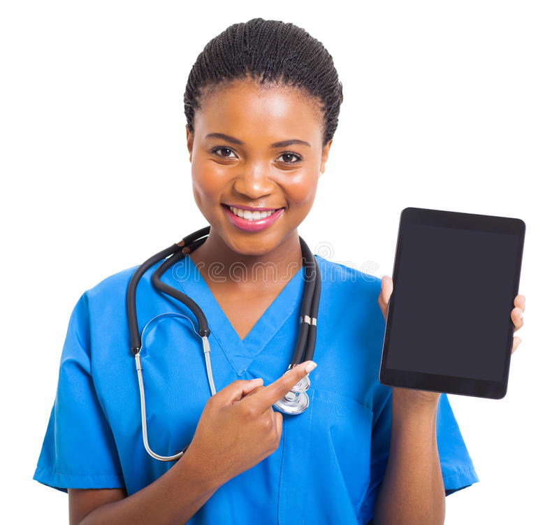 African nurse pointing tablet royalty free stock images