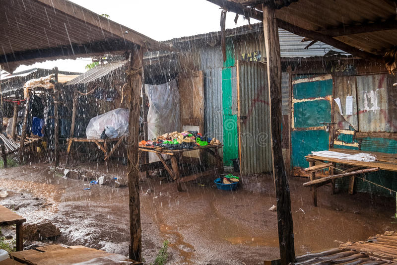 African open air market while raining. Taveta, Kenya royalty free stock photography