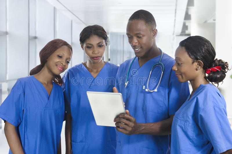 African physician team with tablet PC stock photography