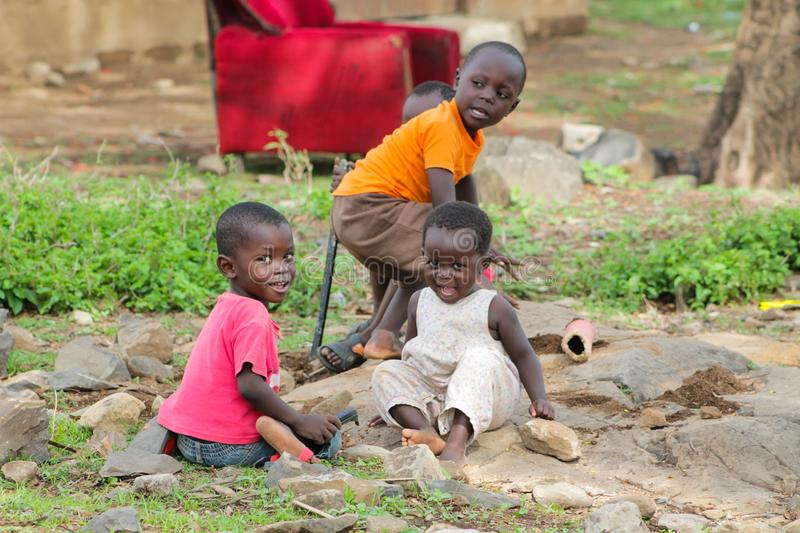 African poor children play on the street. African small poor children boys and girls on the street. Slum african people village life royalty free stock image