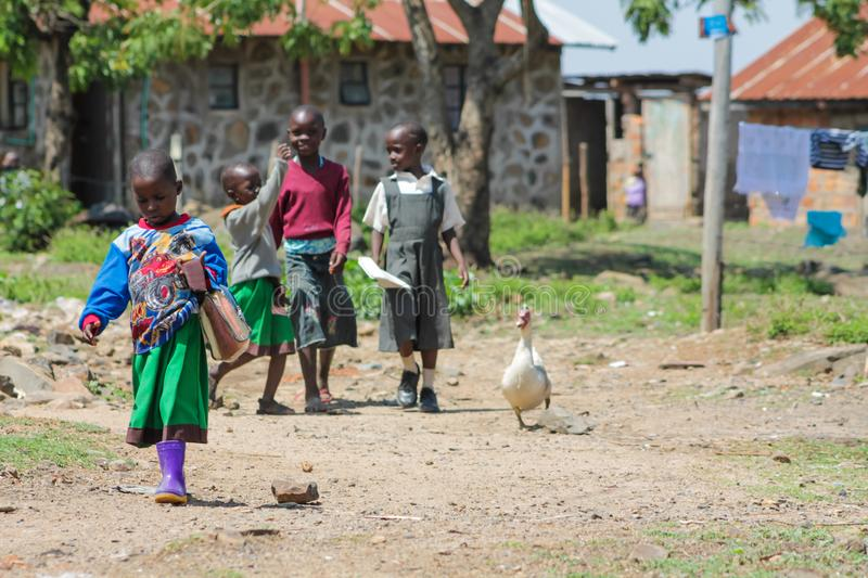African poor children on the street. African small poor children boys and girls on the street. Slum african people village life royalty free stock image